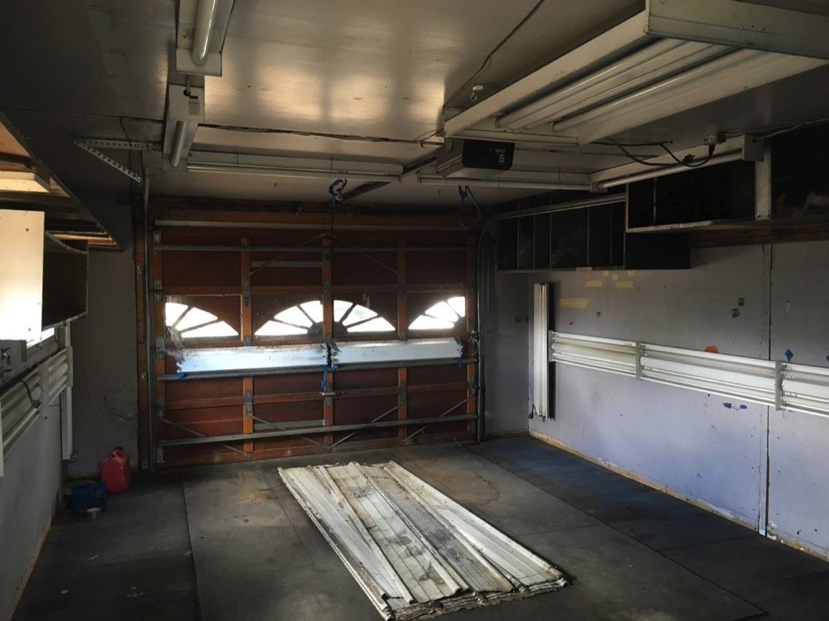 auto body man garage - insulated with lights on walls